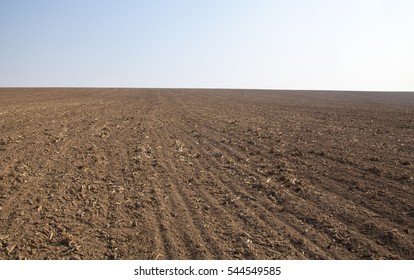 Ploughed field in spring prepared for sowing.