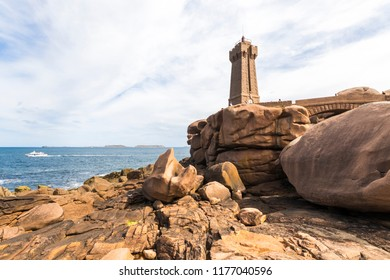 Ploumanac'h, France. The Phare de Mean Ruz, a lighthouse composed of pink granite near Perros-Guirec, Brittany