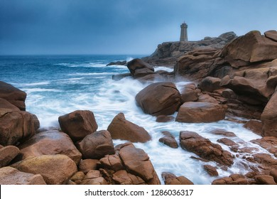 Ploumanach Lighthouse at sunrise in pink granite coast, Perros Guirec, France.