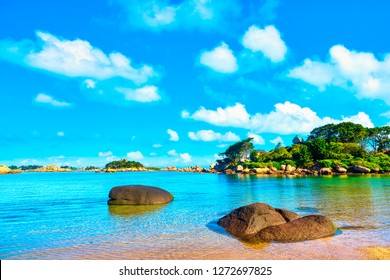 Ploumanach, ock and bay beach in morning. Pink granite coast, Perros Guirec, Brittany, France. Europe