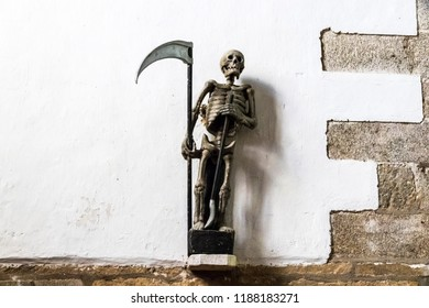 PLOUMILLIAU, FRANCE - Aug 9, 2018: Statue of the Ankou, a 16th century personification of death at the Church of Saint Milliau