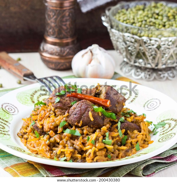 Plov, pilaf with rice, meat, beef, mutton, beans mash, delicious oriental dish