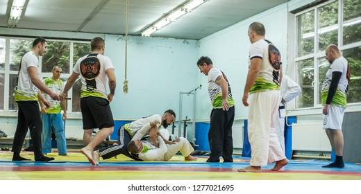 PLOVDIV, BULGARIA - 15. DECEMBER 2018. Kapap Instructor Mitko Galabov with his Students practice BJJ Brazilian jiu-jitsu technique on the AVI NARDIA KAPAP SELF DEFENSE SEMINAR