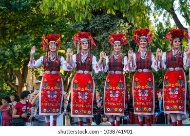 Plovdiv, Bulgaria 3rd August 2013: Beautiful Bulgarian women dancers performing on stage of the XIX International Folklore Festival. The event is free for residents and guests of the town.