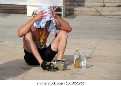 PLOVDIV, BULGARIA - APRIL 29, 2018: Unidentified tired half marathon runner after the event