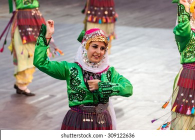 PLOVDIV, BULGARIA - AUGUST 06, 2015 - 21-st international folklore festival in Plovdiv, Bulgaria. The folklore group from Turkey dressed in traditional clothing is preforming Turkish national dances.