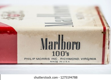 Plovdiv, Bulgaria - December 19, 2018: Vintage Marlboro cigarettes 100s produced in the USA. Banderole on top of the pack.  Red package. Close shot of filter cigarettes pack. US tax exempt for use out