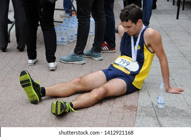 PLOVDIV, BULGARIA - MAY 5, 2019: Exhausted half marathon runner after crossing the finishing line