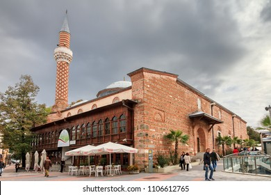 PLOVDIV, BULGARIA - OCTOBER 27, 2014: Beautiful cityscape of Plovdiv, Bulgaria, with locals in the street at the ancient Ottoman Dzhumaya Mosque on October 27, 2014
