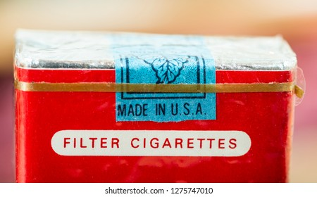 Plovdiv, State / Bulgaria - December 12 2018: Made in USA label. Vintage packet of cigarettes produced in the USA. Banderole on top of the pack.Close shot of filter cigarettes.