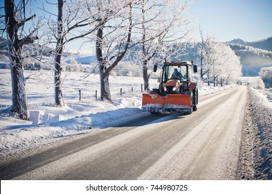 Plow is cleaning road during the winter
