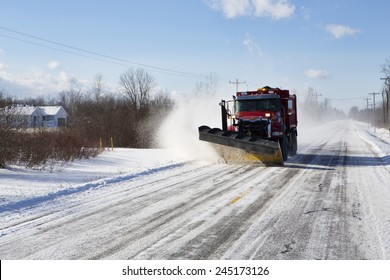 Plow clearing a rural road of snow outside Buffalo, New York.
