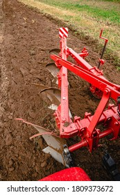 plow plowing the ground top view from the tractor cab, plow work close up, plow in the ground cuts a ditch for planting
