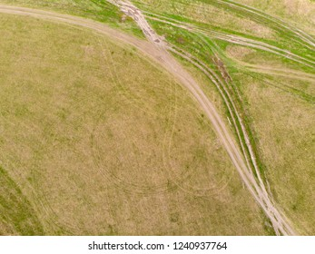 plowed agricultural crop field on which there were traces of the transported vehicles during the processing of the field