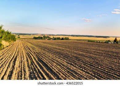 Plowed field in autumn day