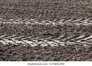 Plowed field fertilized with slurry and tire tracks, Lower Saxony, Germany