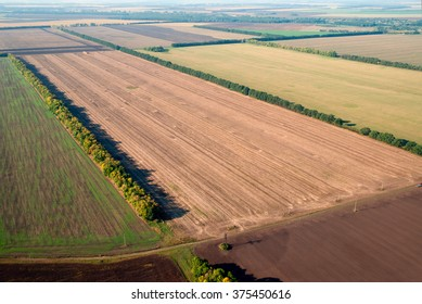 Plowed field and other farmland, the view from a flying helicopter