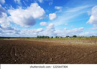 plowed field and small village, Alentejo, Portugal