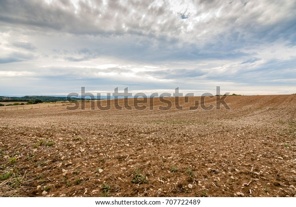 Plowed fields with glowing hills in the rhone valley of France