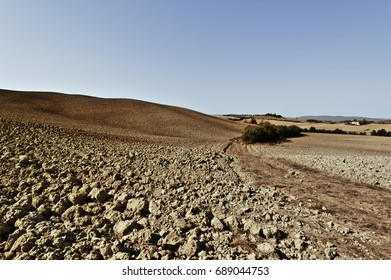 Plowed hills of Tuscany in the autumn. Plowed agricultural land in Italy. Vintage style toned picture