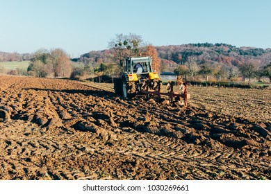 plowed land by a tractor in sunny day