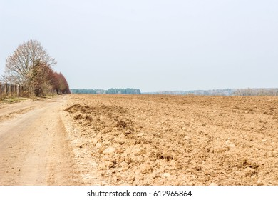 Plowed land for sowing in spring and road