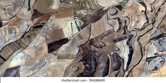 Plowman,allegory, tribute to Picasso, abstract photography of the Spain fields from the air, aerial view, representation of human labor camps, abstract, cubism, abstract naturalism,