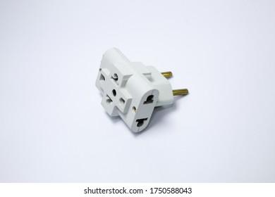 Plug adapter on white background. Power plug. Varied colors.