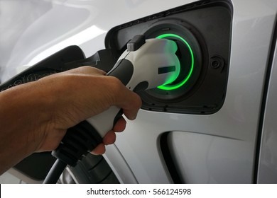 Plug the charger to power To vehicles that use electric power to drive./ green light status full battery.