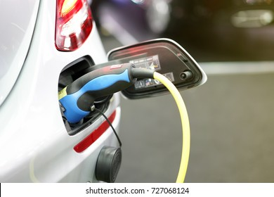 plug of power cable electric supply during charging at ev car (electric vehicle charging)