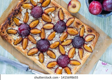 Plum and almond pastry dusted with icing sugar - top view