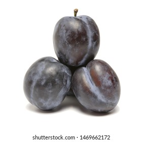 plum berries on top of each other heap on a white background
