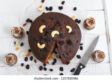 Plum cake made with dried fruit, raisins, cashew nuts, almond etc. Tasty home made cake flavored with cinnamon and spices for sale on Christmas and new year celebration Kerala India. a piece of cake