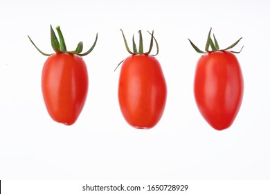 Plum cherry juicy tomatoes isolated on white. Set of italian fresh vegetables. Group of San Marzano tomato. Organic raw vegan healthy food vegetable. Farm market product. Top view, macro, above.