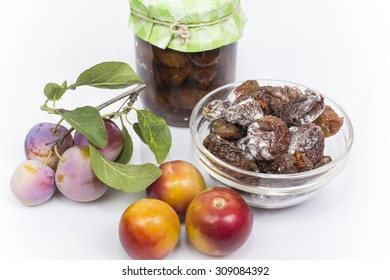 plum fresh and dried on a white background