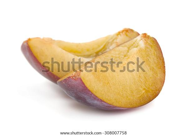 Plum fruit slice closeup isolated on white
