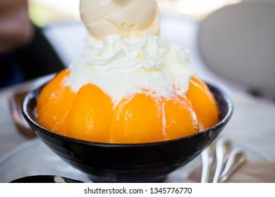 Plum mango Bingsoo with vanilla flavor ice cream on top