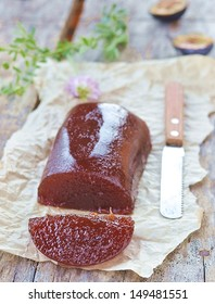 plum paste on the wooden background,