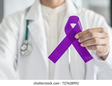 Plum purple ribbon for raising awareness on Alzheimer's disease, breastfeeding, eating disorder, national family caregivers month and epilepsy illness with bow in doctor's hand support