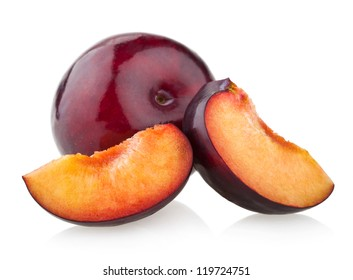 plum with slices isolated on white