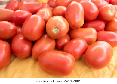 Plum tomatoes for sale at a farmers' market.