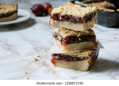 Plumb crumble bars, shortcrust pastry, plum jam topped with a crumble topping