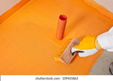plumber builder brush applied waterproofing pipe corner aqueduct