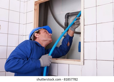 plumber connecting a water pipe & Water Flowing From Pipe Images Stock Photos u0026 Vectors | Shutterstock