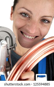 Plumber with copper pipe and bending tool