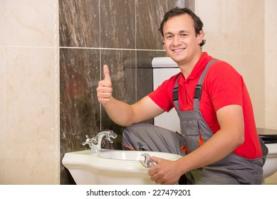 Plumber during his work in the toilet.