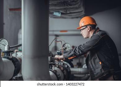 a plumber engineer repairing pipes at work