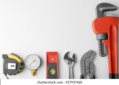 Plumber equipment on light background