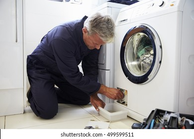 Plumber Fixing Domestic Washing Machine