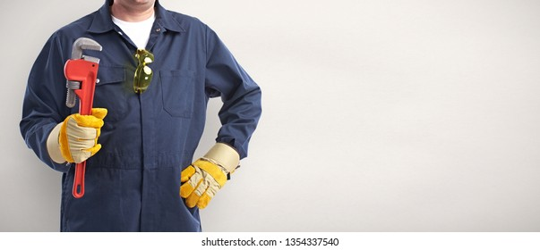 Plumber hand with wrench.
